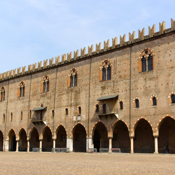 Mantua, Italy - June 15, 2013: The Captain's Palace in Piazza Sordello, was built by Paolo Bonacolsi at the beginning of the 14th century and it is one of the most ancient parts of the complex called Palazzo Ducale (Ducal Palace). Mantua, Lombardy, Italy. Some people around.
